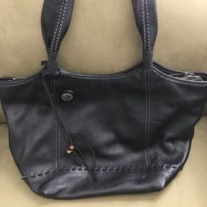 Black leather large zippered handbag.